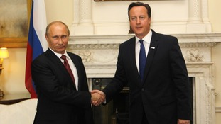 Prime Minister David Cameron and Russia's President Vladimir Putin  meet to discuss the Syrian crisis