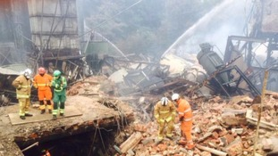 Firefighters at the scene of the blast