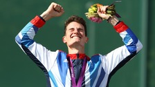 Team GB's Peter Wilson receives gold after winning the double trap men's final.