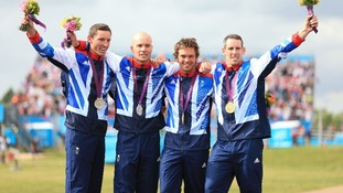 GB's David Florence and Richard Hounslow with their silver medals celebrate with Tim Baille and Elienne Stott with their gold medals.