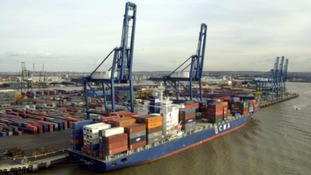 A general view of a container ship at Tilbury Docks in Essex.