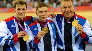 Chris Hoy (right), Jason Kenny (left) and Philip Hindes after winning gold in the men's team sprint.