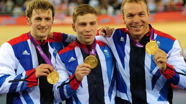 Chris Hoy (right), Jason Kenny (left) and Philip Hindes after winning gold in the men&#x27;s team sprint.