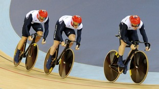 Great Britain's cycling sprint team cycling towards gold.