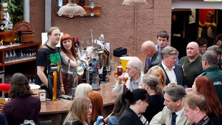 People in the Clutha Bar, Glasgow, as it reopens after a police helicopter crash in 2013