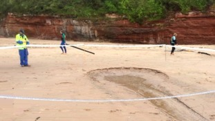 Large sinkhole re-appears on Exmouth beach