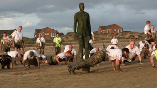 Participants completing press-ups on Crosby beach