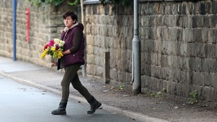 A woman was seen bringing flowers to the construction site in the Worsbrough area of Barnsley.