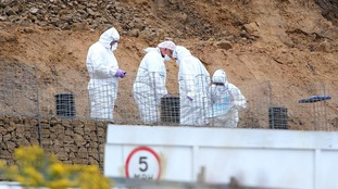 Police forensic officers were seen searching the site after the body was found at 8.30am.