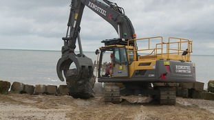 Coastal sea defences are moved to try to protect Norfolk village.