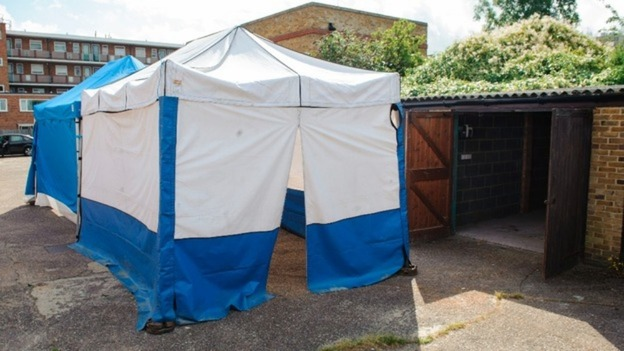 Body found in lock-up in a row of garages behind a quiet street