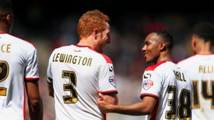 Rob Hall (right) celebrates scoring for MK Dons last season.