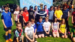 Children in Jedburgh pose with the Rugby World Cup