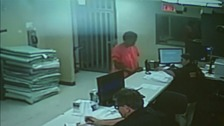 Video shows Sandra Bland having mugshot taken by police.
