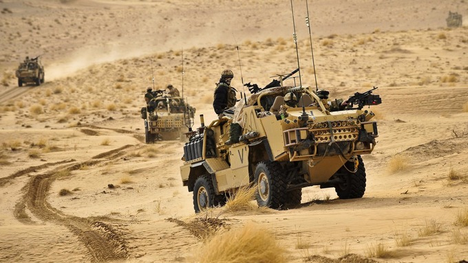 British Army Jackals on patrol through the Eastern Desert in Helmand Province, Afghanistan.