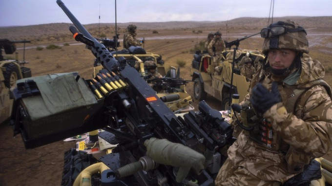 Trooper Liam Davies, 21, from Wrexham, mans a .50 calibre machine gun on top of a Jackal with the 1st The Queens Dragoon Guard