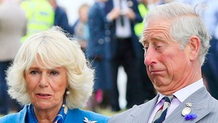 The Prince of Wales and the Duchess of Cornwall react as they meet the Army Air Corps mascot, bald eagle Zephyr.