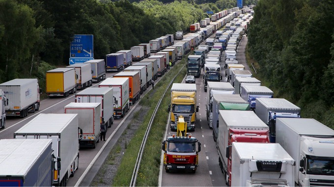 Lorries queue along the north and southbound carriageways of the M20 in Kent on Wednesday.