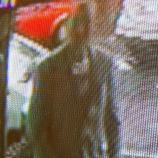 The CCTV image of a man Bedfordshire Police want to trace following an arson attack in Dunstable.