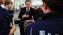 Prime Minister David Cameron meets apprentices during a visit to Rolls Royce Learning and Career Development Centre at Derby.