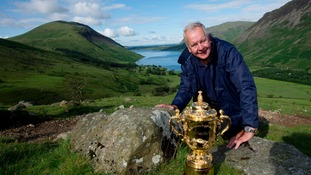 RFU Chairman Bill Beaumont with the Webb Ellis Cup on Scafell Pike
