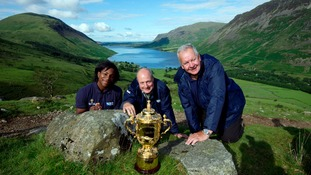 England Women's Rugby World Cup winner and England Rugby 2015 ambassador Maggie Alphonsi, RFU Board Member Ian Metcalfe and RFU Chairman Bill Beaumont, with the Webb Ellis Cup on Scafell Pike