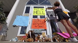 Protesters have left angry messages outside Palmer's dental surgery