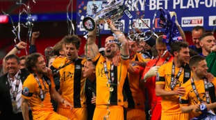 John White (centre) lifts the League Two play-off trophy.