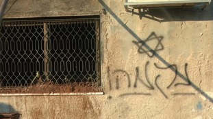 Star of David graffiti daubed on the wall.