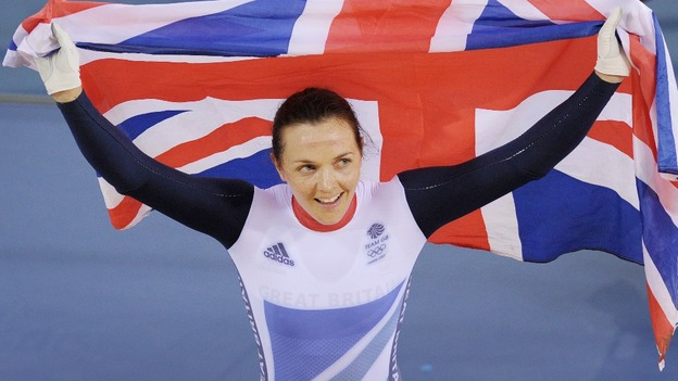 Victoria Pendleton raises the Union flag after her medal win.