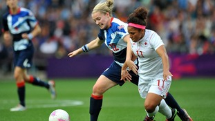 Canada's Desiree Scott and Great Britain's Kim Little battle for the ball during the Quarter Final match