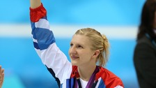 Adlington waves to the crows after the medal ceremony for the women's 800m freestyle event.