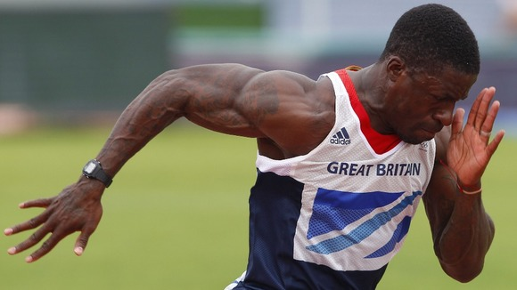 Dwain Chambers works on his starting technique during a Team GB athletics training session in Portugal.