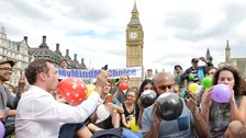 "Protesters simultaneously breathed in the ""laughing gas"" in Parliament Square."