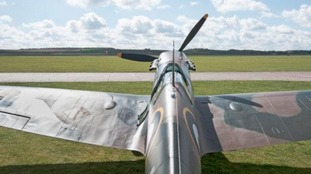 Pilot crash lands Spitfire