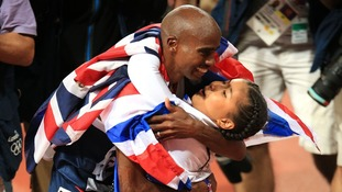 Great Britain's Mo Farah celebrates winning the men's 10,000m final with his daughter Rihanna.