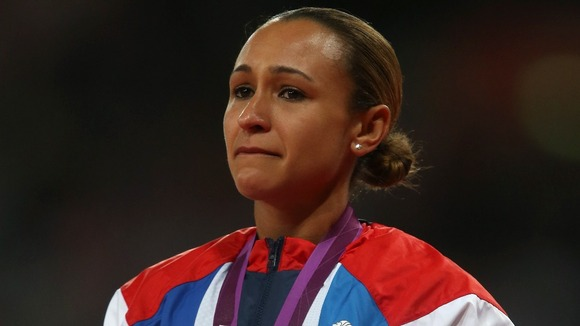 Jessica Ennis listens to the national anthem on the podium with her gold medal.