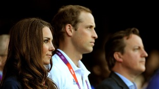 The Duke and Duchess of Cambridge and Prime Minister David Cameron watch the evening session.