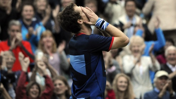 Murray can't hide his emotion after reaching the mixed doubles final alongside Robson.
