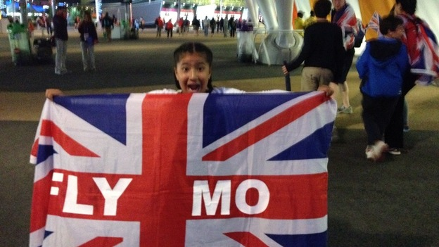 Farah&#x27;s daughter Rihanna holds up a Team GB flag with pride and celebrates.