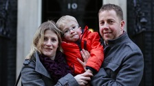 Sam Brown, with parents Katy and Simon outside Downing Street