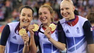 Britain's Dani King, left, Laura Trott, center, and Joanna Rowsell right, show their gold medals in the track cycling women's pursuit team.