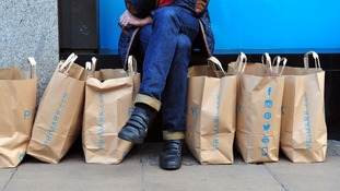 A shopper makes the most of Primark.