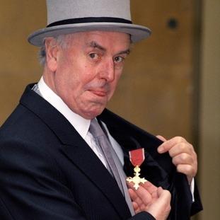 Cole collecting his OBE at Buckingham Palace in 1992.