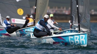Great Britain's Ben Ainslie during the Men's Finn Medal Race with Denmark's Jonas Hogh-Christensen (left) close behind