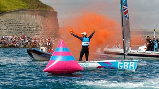 Ben Ainslie celebrates in Weymouth