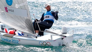 Great Britain's Ben Ainslie celebrates winning the Gold Medal after the Men's Finn Medal Race in Weymouth.