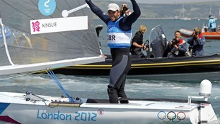 Britain's Ben Ainslie celebrates as he crosses the finish line to win the Finn class at the London 2012 Olympic Games.