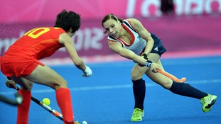 reat Britain's Kate Walsh wears a jaw guard while competing at the Riverbank Arena