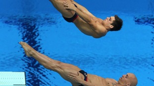 Chris Mears (top) and Nick Robinson-Baker dive during the Mens's Synchronised 3m Springboard